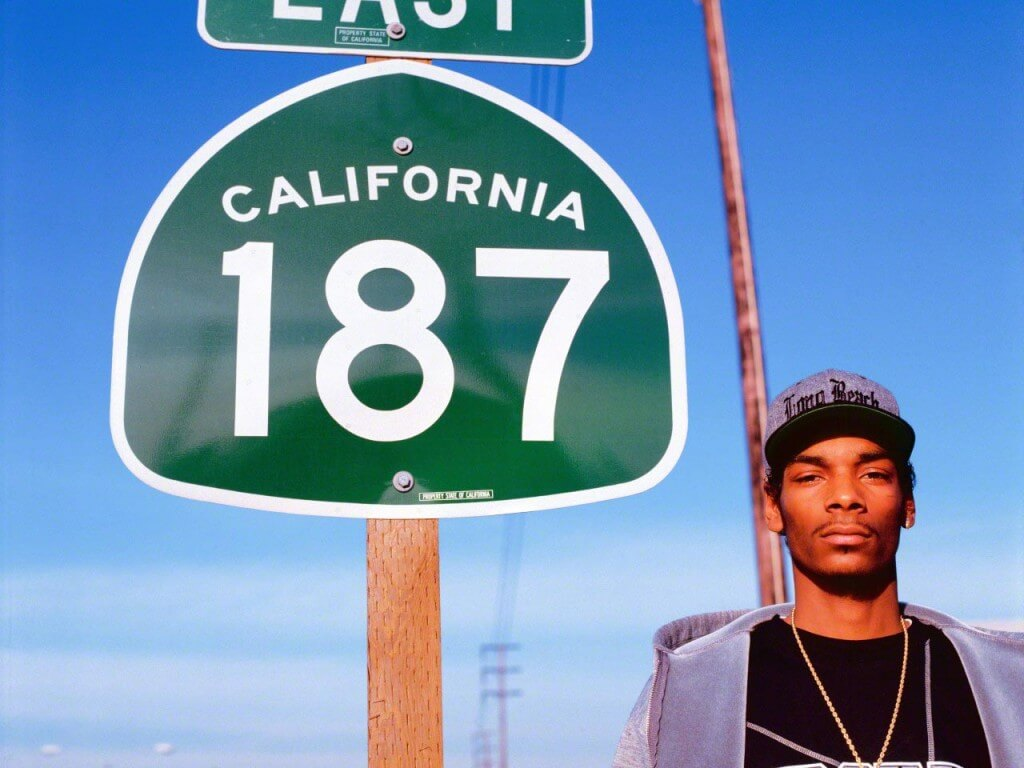 25 Mar 1993, Los Angeles, California, USA --- Snoop Doggy Dogg standing at the Route 187 sign in Los Angeles, California --- Image by © Chi Modu/Diverse Images/Corbis