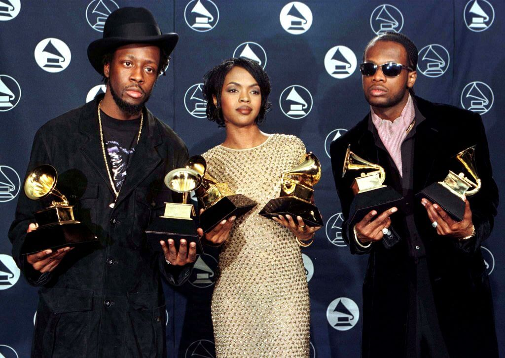 "The Fugees (from left) Wyclef Jean, Lauryn Hill and Prakazrel Michel pose with the Grammy they won for the Best R & B Performance by a Duo or Group for ""Killing Me Softly With His Song"" at the 39th Grammy Awards at Madison Square Garden in New York February 30."