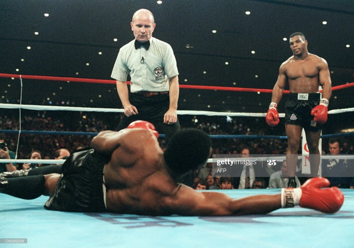 """""""Iron"""" Mike Tyson beat Trevor Berbick to become youngest heavyweight in boxing history."""